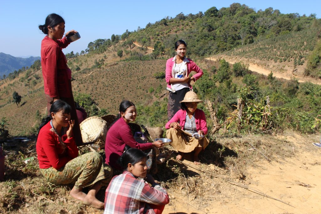 Women take a rest on the side of the road. Many women and families have been forced to flee and leave their farms due the fighting in northern Shan State. (Photo: Libby Hogan / DVB)