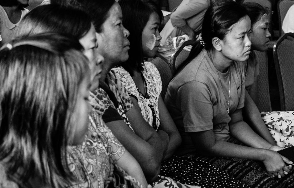 Young women listen to a victim of rape and torture talking at a conference IN Rangoon on the weekend. (Photo: Libby Hogan / DVB)